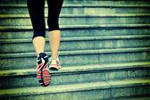 Woman legs running on  stairs — Stock Photo
