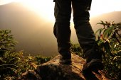 Woman hiker stand on mountain — Stock Photo
