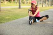 Woman runner stretching legs outdoor — Stock Photo