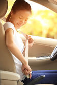 Woman driver buckle up the seat belt driving car — Stock Photo