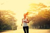 Young fitness woman runner running outdoor — Stock Photo