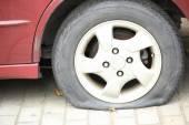 Flat tire on car wheel — Стоковое фото