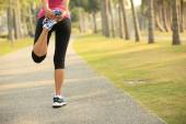 Woman runner warm up outdoor — Stock Photo