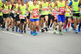 SHENZHEN,CHINA - DECEMBER 7: marathon runners on the street at Shenzhen International Marathon DECEMBER 7, 2014 in Shenzhen, China — Stock Photo
