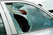 Window smashed by a thief — Stock Photo