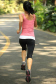 Runner athlete running at road. woman fitness jogging workout wellness concept. — Stock Photo