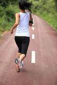 Young fitness woman jogging — Stock Photo