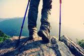 Woman hiker on mountain rock — Stock Photo