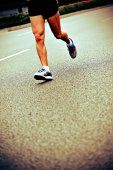Athlete running at marathon — Stock Photo