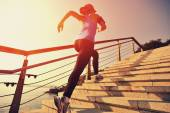 Runner athlete running up stairs — Stock Photo