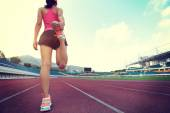 Woman warming up before running — Stock Photo