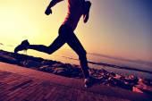 Female athlete running at seaside — Stock Photo