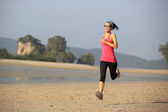 Healthy woman running at beach — 图库照片