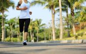 Female running at tropical park — Stock Photo