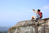 Woman hiker taking photo with smartphone — Stock Photo