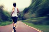 Fitness woman running at trail — Stock Photo