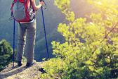 Woman hiker legs on mountain peak — Stock Photo