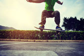 Young female skateboarder — Stock Photo