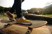 Skateboarder legs skateboarding — Stock Photo