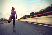 Woman runner warming up — Stock Photo