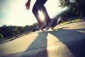 Skateboarder legs doing  trick ollie — Photo