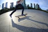 Skateboarder legs skateboarding at city — Stock Photo