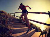 Fitness woman running up stairs — Stock Photo