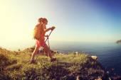 Woman hiking on seaside — Stock Photo