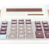 Calculator close-up shot focus on percentage  — Stock Photo
