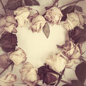 Fading rose. Dead Roses frame  in the form of heart — Stock Photo