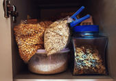 Open kitchen cabinet. Cereals on the kitchen shelf. — Stock Photo