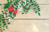 Greeting card with red hearts and white flowers on wooden backgr — Fotografia Stock