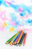 Colored pencils  on blurred colorful background — Stock Photo