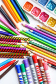 Colored pencils, crayons, markers and paints on white background — Stock Photo