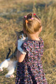 Little girl with a cat in the hands  — Stock Photo