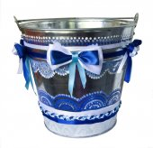Iron pail with bows of ribbons — Stock Photo
