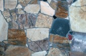 Texture of wall with mosaic set stone — Stock Photo