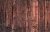 Texture of the walls of boards, painted with red paint — Zdjęcie stockowe