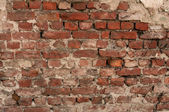 Texture of old red brick wall with remains of plaster — Stock Photo