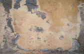 Texture of old wall covered with yellow stucco — ストック写真