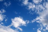 Texture of blue sky with clouds and new moon — Stock Photo