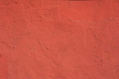 Texture of old wall covered with red stucco — Stock Photo