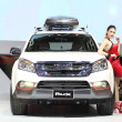 Постер, плакат: BANGKOK November 28: Isuzu MU X car with Unidentified model on