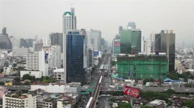BANGKOK,THAILAND - April 8,2014 :Top view Bangkok and Sky Train of Bangkok going out from station another one going to station — Stock Video