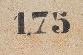 1.75 marker on stone — Stock Photo