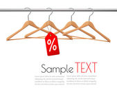 Coat hangers on a clothes rail. Discount promotion concept. Vect — Stock Vector