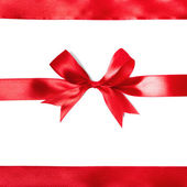 Shiny red satin ribbon on white background — Стоковое фото