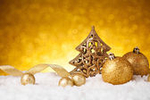 Golden christmas fir tree decoration — Stock Photo