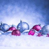 Christmas ornament in snow on glitter background — Zdjęcie stockowe