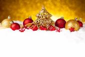 Golden christmas fir tree decoration with gold and red ornaments — Stock Photo